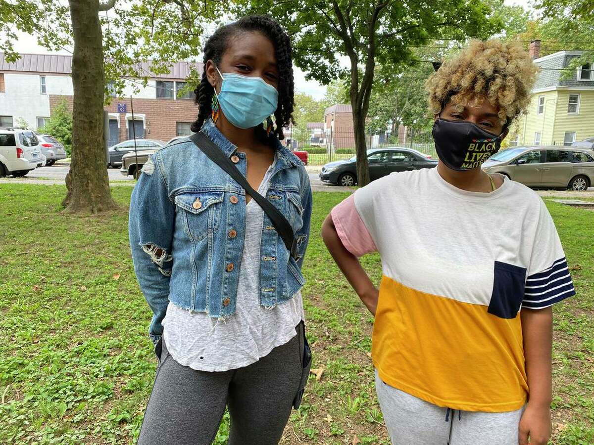 Nia Campina Bacote, left, Lucretia Gill in Kensington Park, both are nearby residents to the park who view it as an asset.