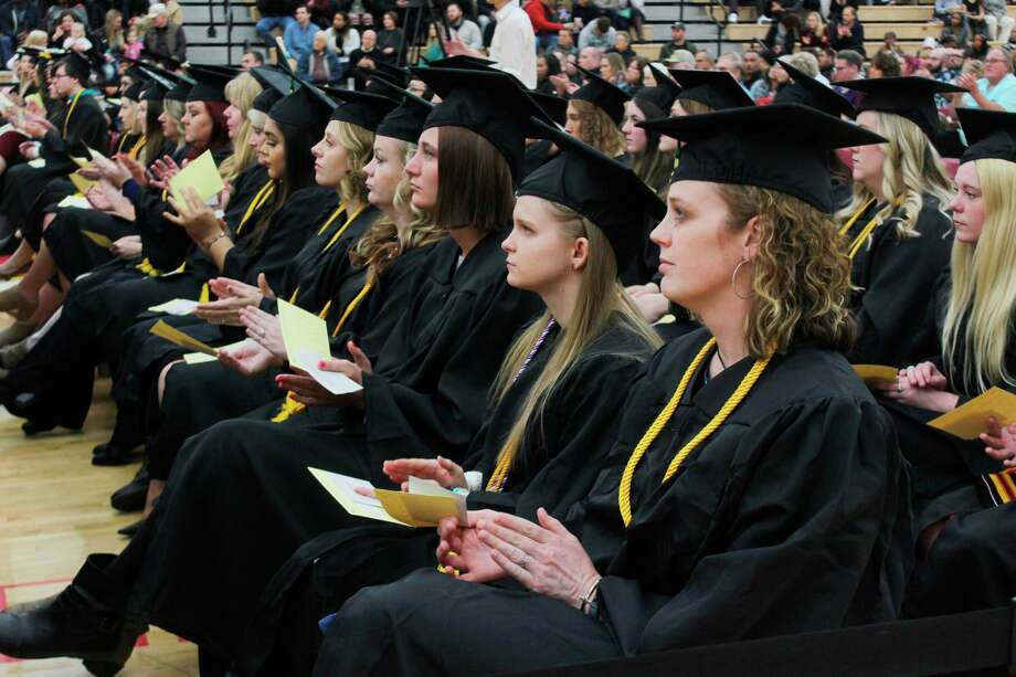 Ferris students wait to receive their diplomas during a previous graduation ceremony. This December, the ceremony will be virtual. (Pioneer file photo)