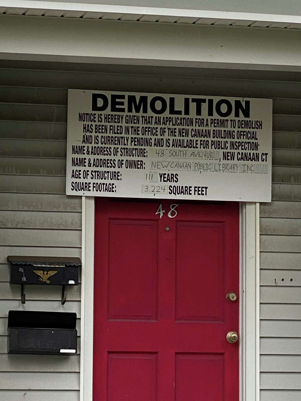 A notice of demolition was hanging over the door of the 111-year-old home at 48 South Ave. in New Canaan, on Tuesday, Sept. 29. The 3,224 square- foot building is owned by the New Canaan Library.