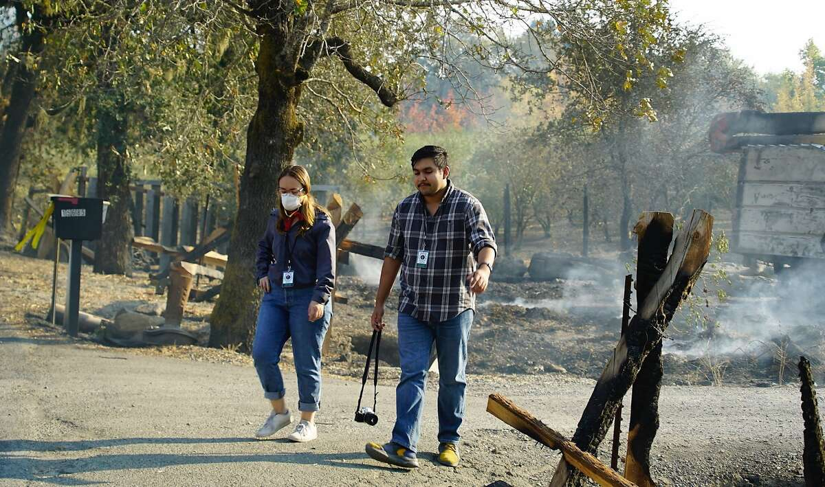 Riley Palmer and Abraham Fuentes, journalists for the Santa Rosa Junior College Oak Leaf newspaper, cover the Kincade Fire in 2019.