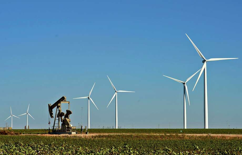 Wind turbines and oil pumpjack in action Tuesday, Oct. 27, 2015, north of Stanton, Texas. Photo: James Durbin / James Durbin / © 2015 Midland Reporter Telegram. All Rights Reserved.