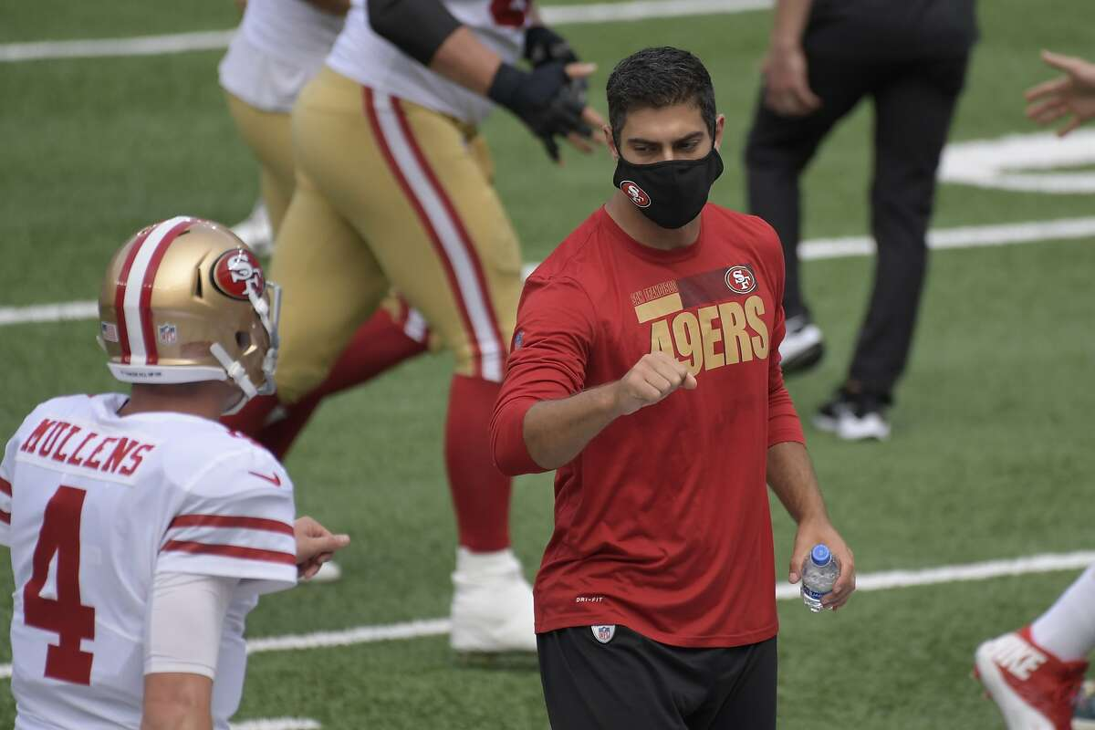 If Jimmy Garoppolo looks healthy Friday, he could play Sunday, but Nick Mullens (left) appears likely to start.