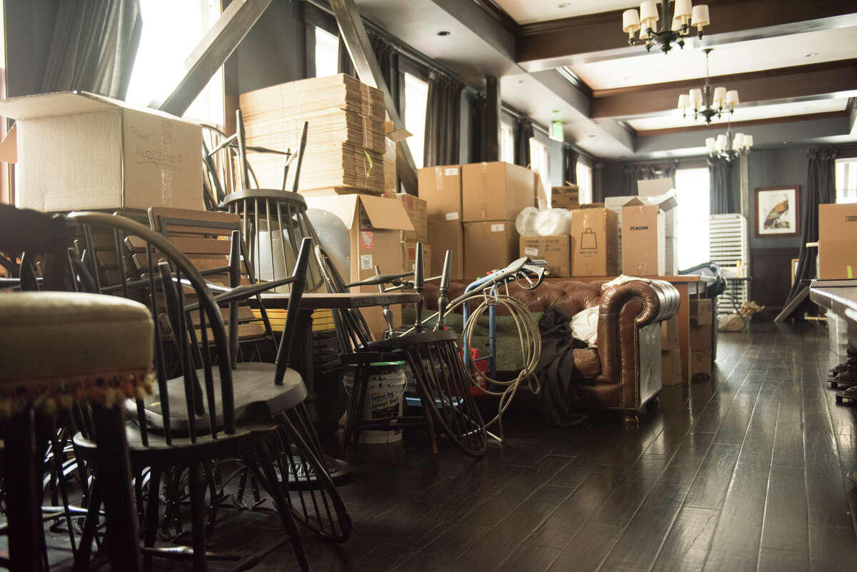A former dining area at Wayfare Tavern has been converted into both table storage and an area where the group prepares lunches for SF New Deal.