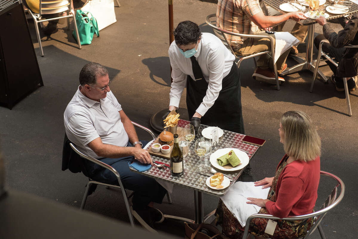 A pair of diners enjoy their meal at Wayfare Tavern in its outdoor space in October 2020. On Dec. 6, San Francisco shut down outdoor dining once again.