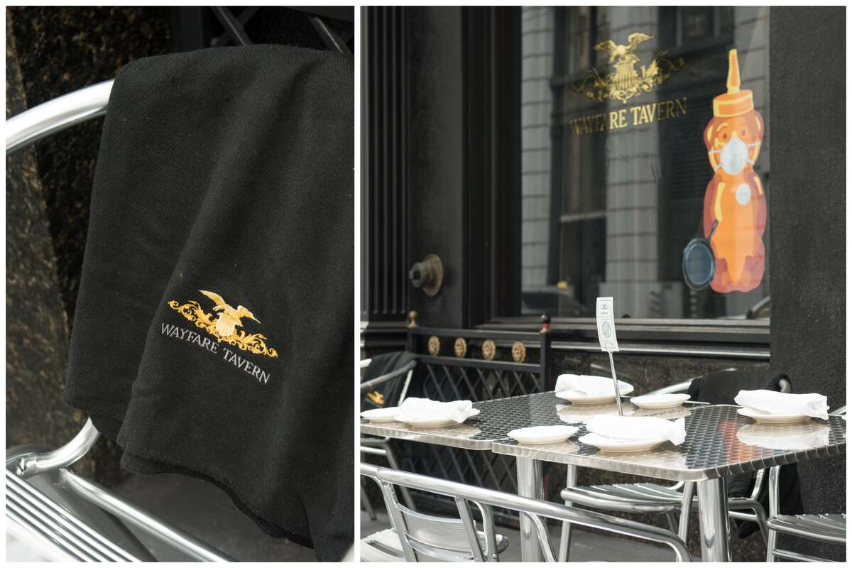 The outdoor dining area of Wayfare Tavern has some personal touches to its seating, including blankets for customers.