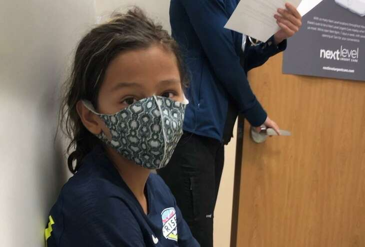 Still in his soccer uniform and cleats at a Southwest Houston clinic on a recent Sunday, Dane Schiller's son seconds after he heard the results of his coronavirus test.