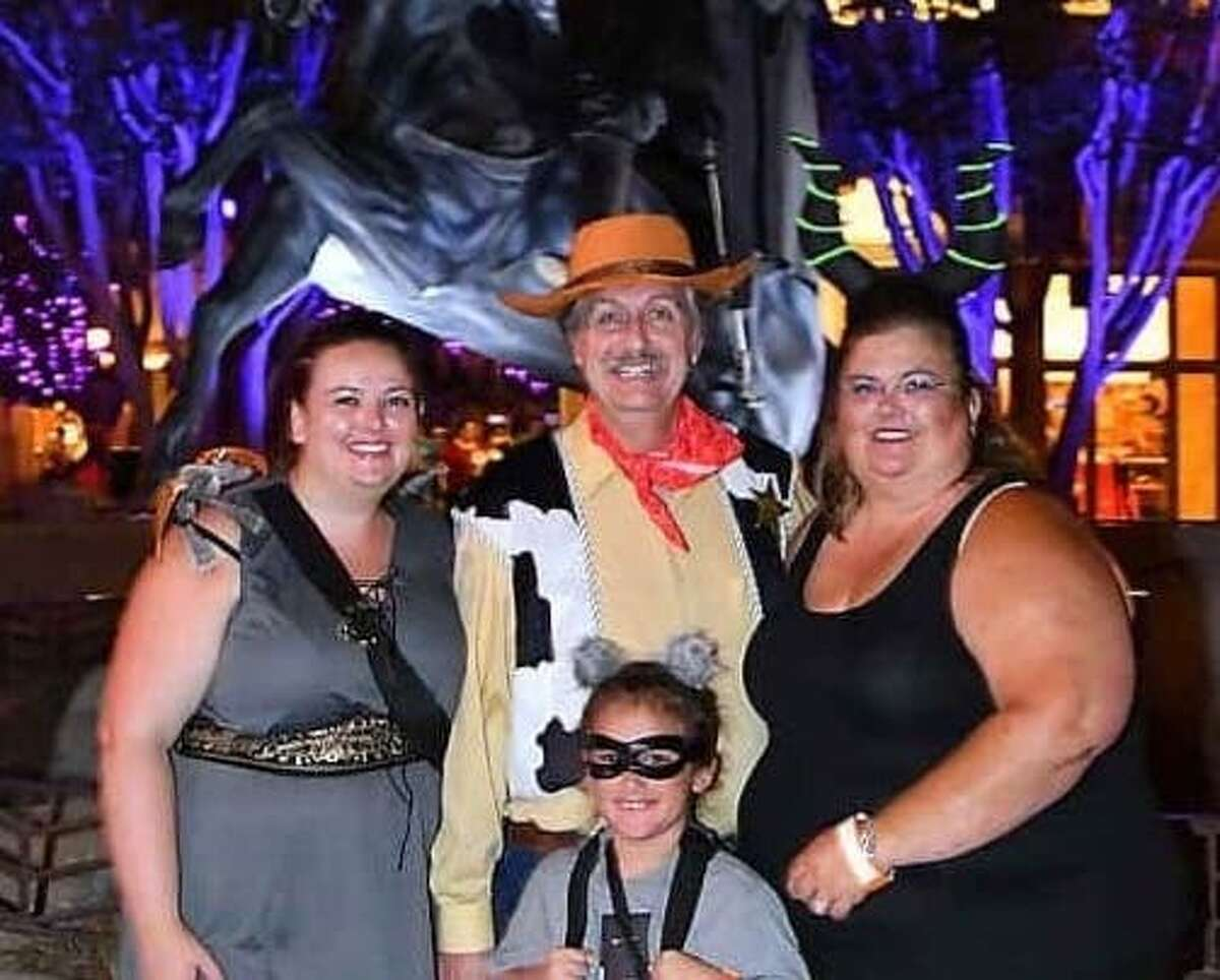Kathy Johnson (right) and her husband, granddaughter, and daughter, who got married in Disneyland.