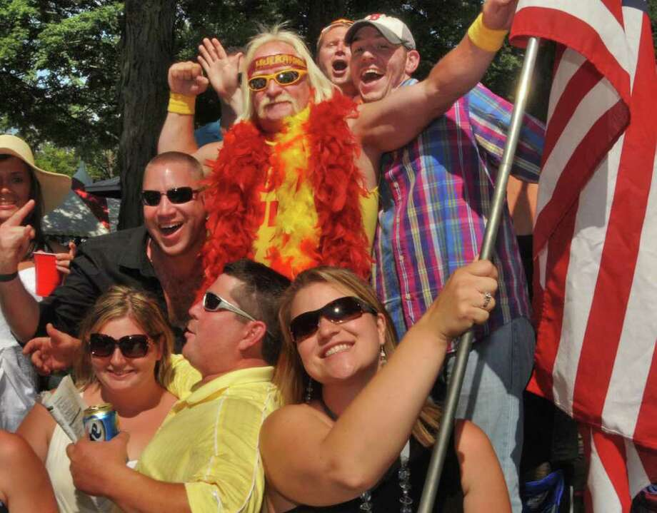 Hulk Hogan impersonator Johnny Enright, center, of Malta with fans at Saratoga Race Course Saturday afternoon August 28, 2010.  (John Carl D'Annibale / Times Union) Photo: John Carl D'Annibale / 00009793A