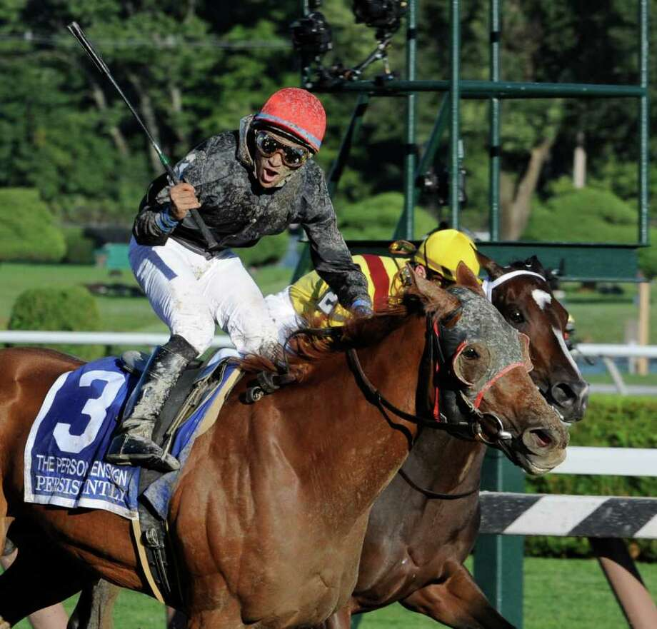 Jockey Alan Garcia shows his jubilation after upsetting Rachel Alexandra with jockey Calvin Borel  to win the 63rd running of The Personal Ensign at the Saratoga Race Course at Saratoga Springs August 29, 2010.  (Skip Dickstein/Times Union) Photo: Skip Dickstein