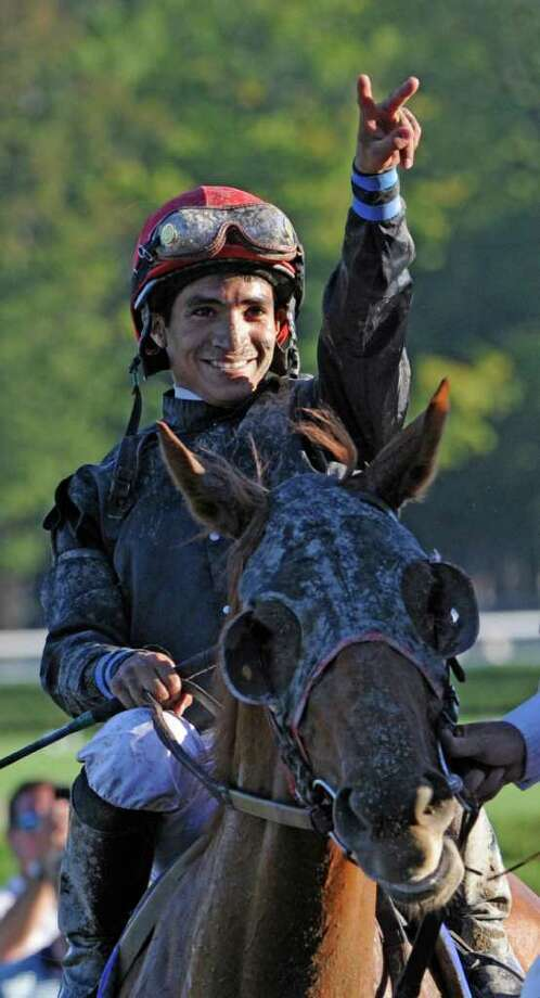 Jockey Alan Garcia is jubilant after after upsetting Rachel Alexandra in the 63rd running of The Personal Ensign at the Saratoga Race Course at Saratoga Springs August 29, 2010.  (Skip Dickstein/Times Union) Photo: Skip Dickstein