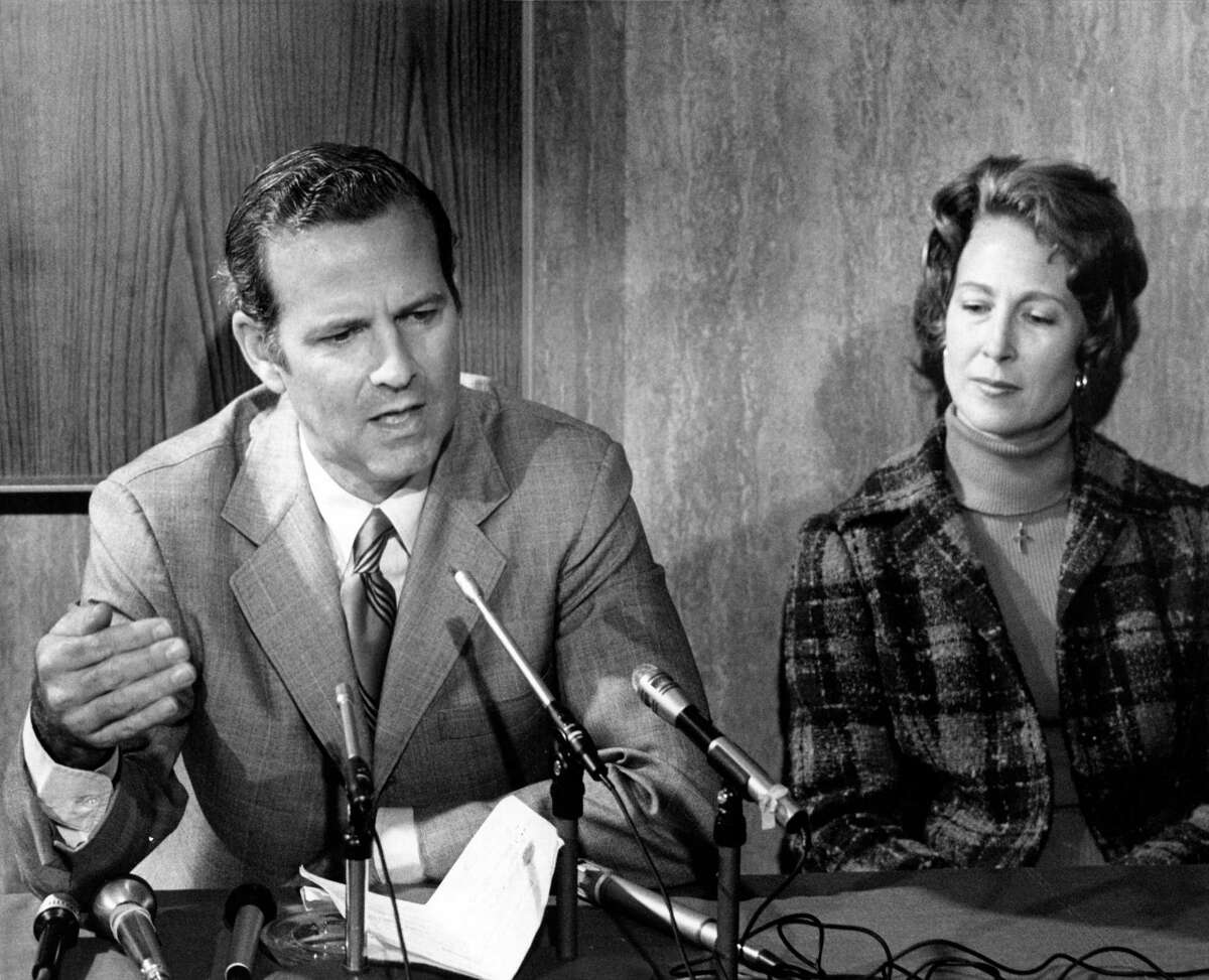 01/31/1978 - James Baker III, candiidate for Texas Attorney General, speaks to news media. His wife, Susan, listens at right.