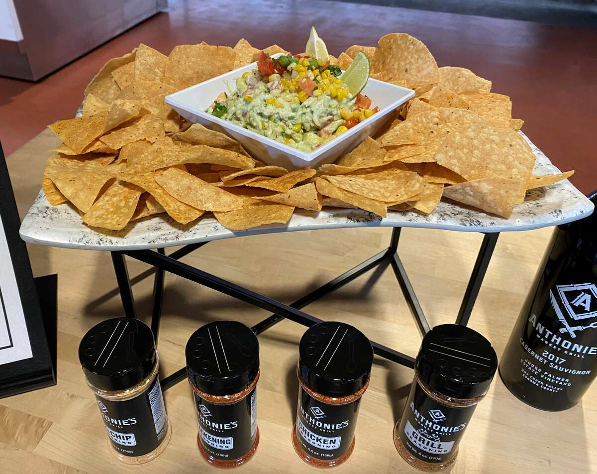 Anthonie's Market Grill's Crab Ranchero Dip: Lump Blue Crab mixed with pico de gallo, mesquite-fired roasted corn, avocado and homemade ranch served zesty ranch chipis with Anthonie's chip and fry seasoning.