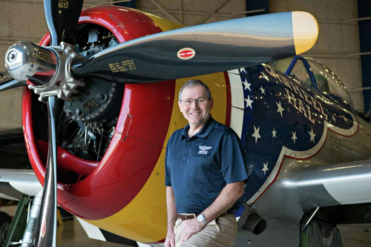 Retired Lt. Gen. Doug Owens, president and CEO of Lone Star Flight Museum, poses beside an aircraft. The museum has a full lineup of fall events scheduled.