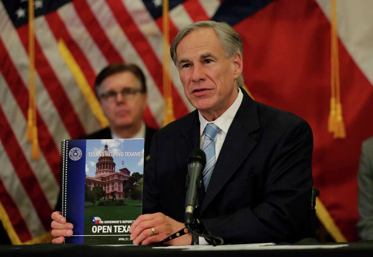 Texas Gov. Greg Abbott holds the Governor's Report to Reopen Texas book during a news conference where he announced he would relax some restrictions imposed on some businesses due to the COVID-19 pandemic, April 27, in Austin.