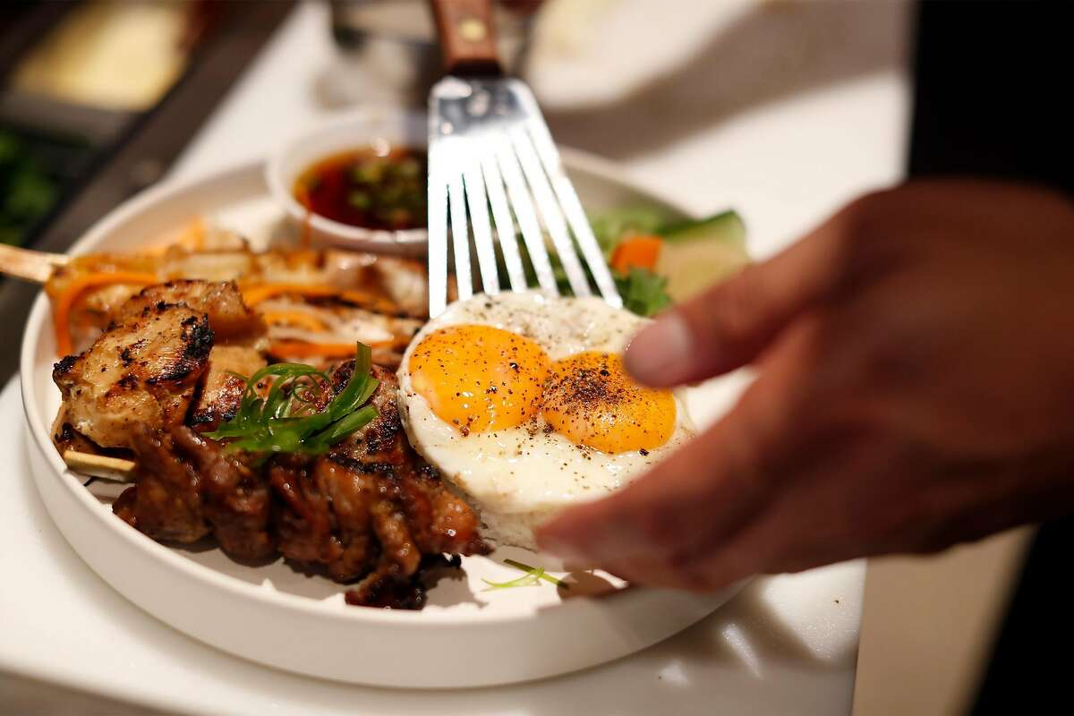 Chef Rob Lam prepares the #1 Dac Biet Rice Bowl, featuring eggs from a secret supplier.