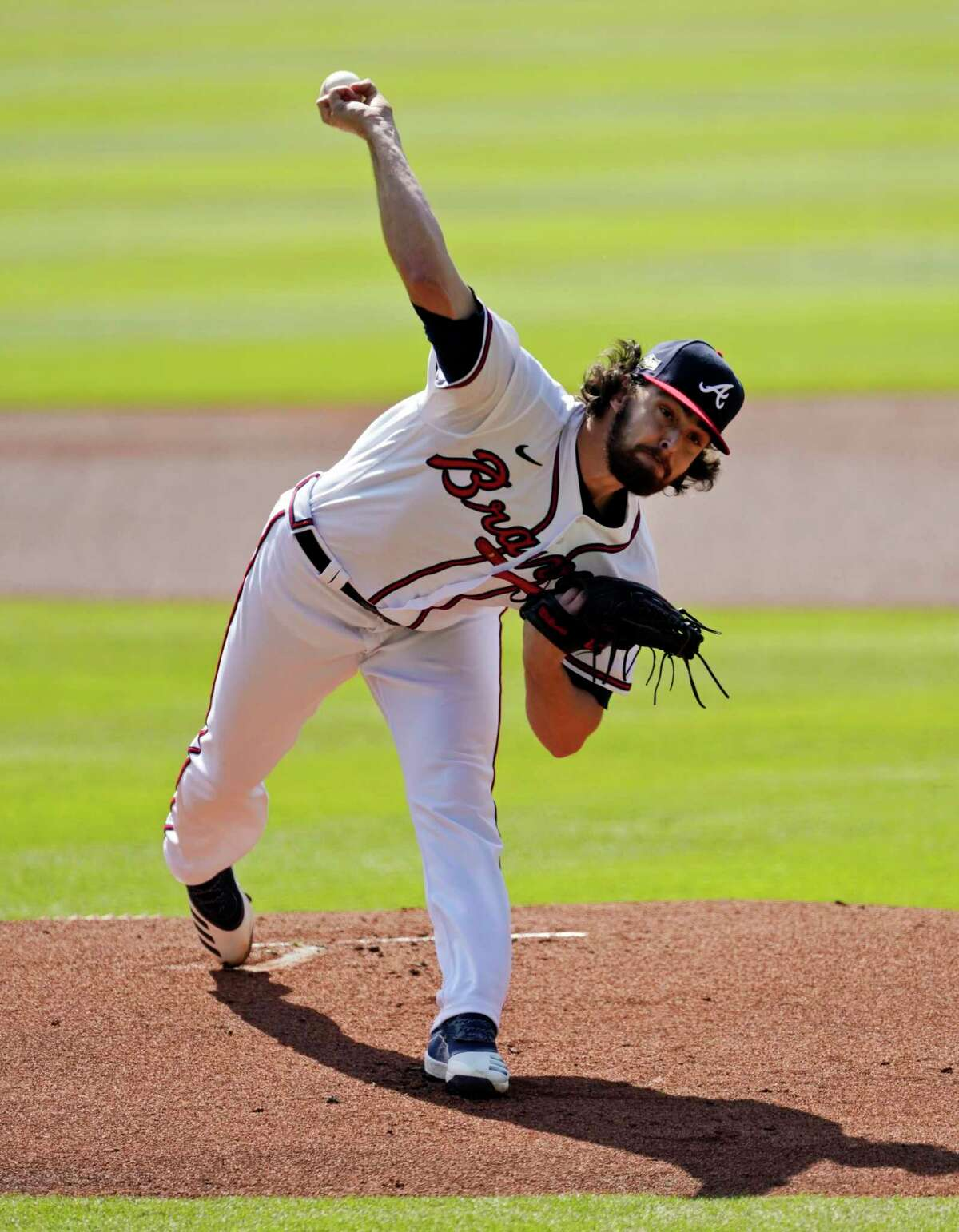 Atlanta Braves starting pitcher Ian Anderson throws during the first inning in Game 2 of a National League wild-card baseball series, Thursday, Oct. 1, 2020, in Atlanta.
