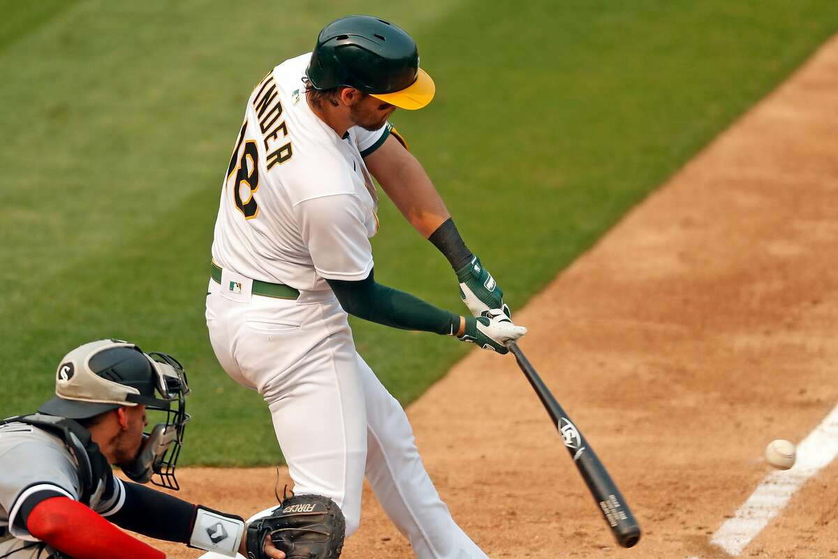 Oakland Athletics' Chad Pinder hits a 2-run single in 5th inning against Chicago White Sox during Game 3 of Wild Card Series at Oakland Coliseum in Oakland, Calif., on Thursday, October 1, 2020.