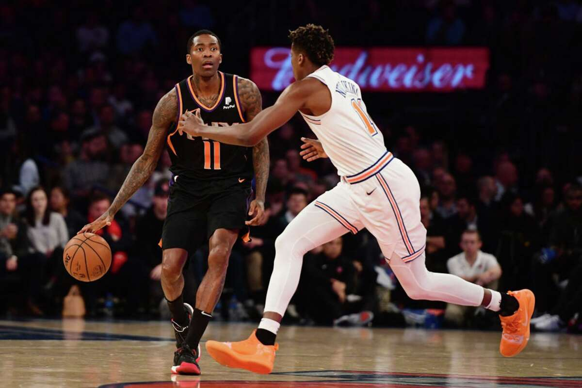 FILE PHOTO: Jamal Crawford, of the Phoenix Suns, controls the ball against Frank Ntilikina, of the New York Knicks, during the first quarter of the game at Madison Square Garden on Dec. 17, 2018 in New York City.