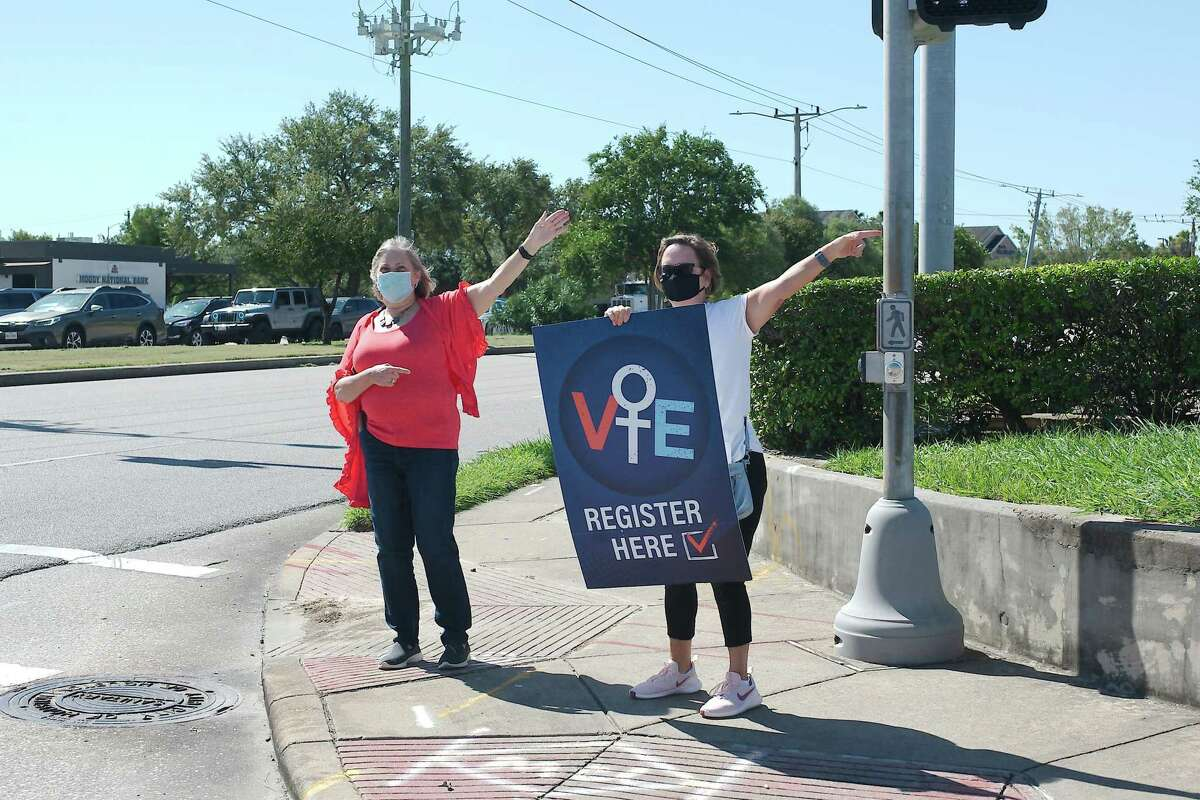 Nancy Steger and Linda Berlinger direct people wishing to register to vote at a recent League of Women Voters registration site at the Harris County Freeman Library in Clear Lake.