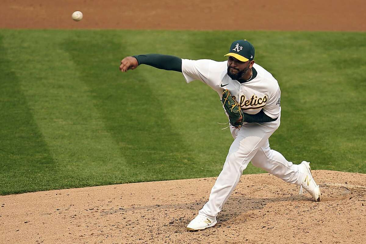 Yusmeiro Petit was the first of seven relievers the A's used after Mike Fiers was pulled in the second.