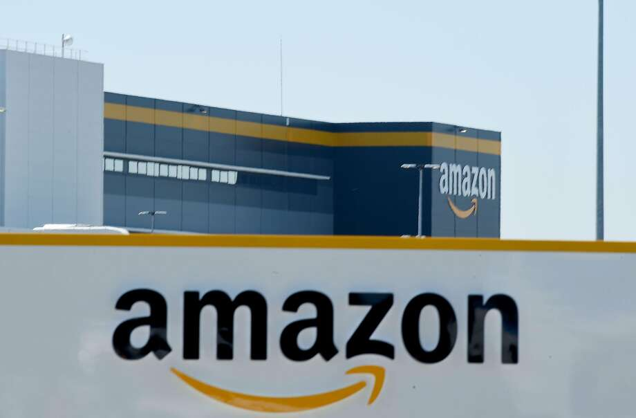 (FILES) In this file photo taken on May 19, 2020  in Bretigny-sur-Orge on May 19, 2020 shows a sign with the company's logo at Amazon's centre entrance as Amazon France partially reopens amid the pandemic of the novel coronavirus (COVID-19). - Amazon on September 29, 2020, defended its warehouse safety record after a news investigation pointed to a higher-than-average injury rate in the company's massive logistics operations. (Photo by ERIC PIERMONT / AFP) (Photo by ERIC PIERMONT/AFP via Getty Images) Photo: Eric Piermont, AFP Via Getty Images
