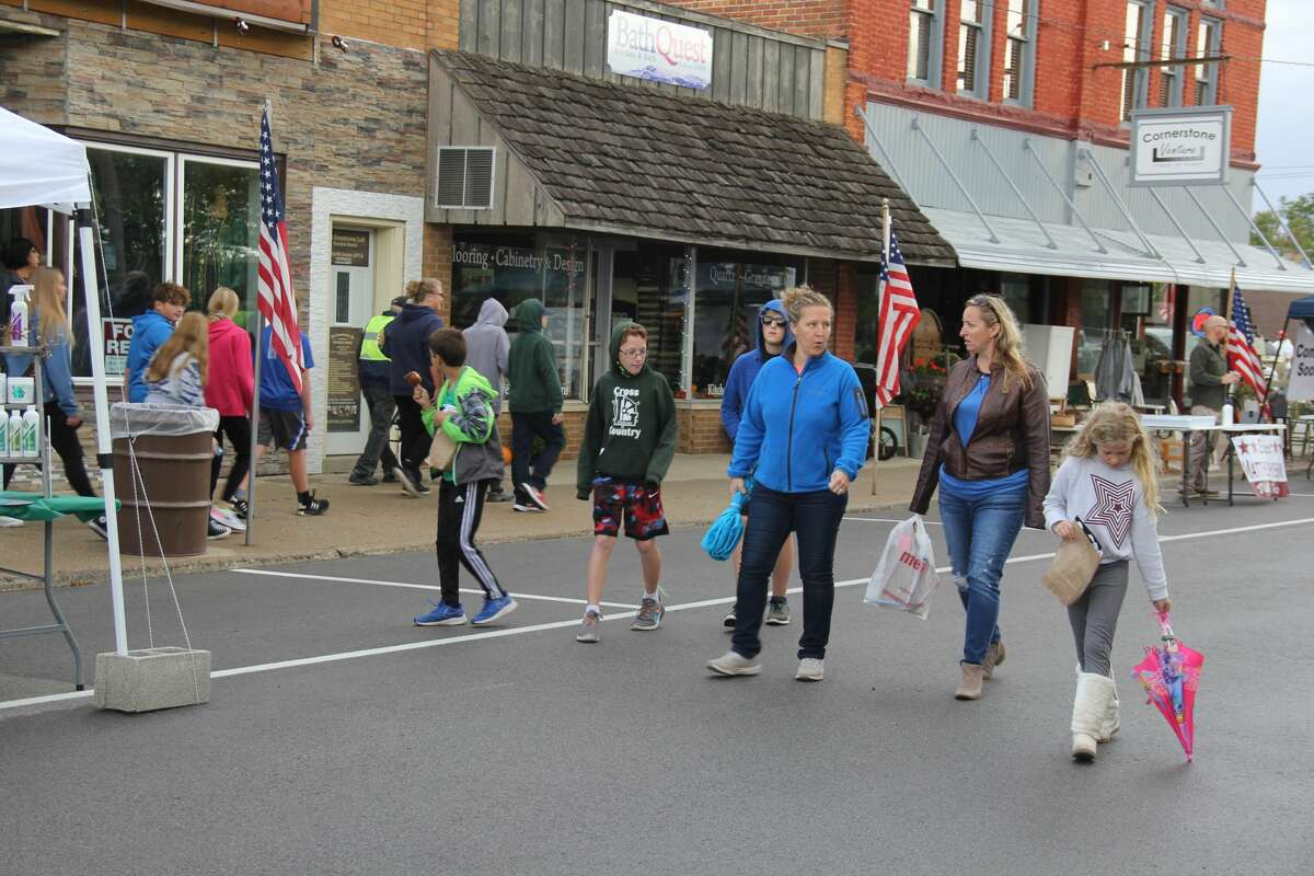 Sebewaing residents braved the rain to see what the village's Moonlight Madness and River Fire had to offer. Vendors lined Center Street to sell autumn goods while storefronts offered their own ways of getting people to come inside.