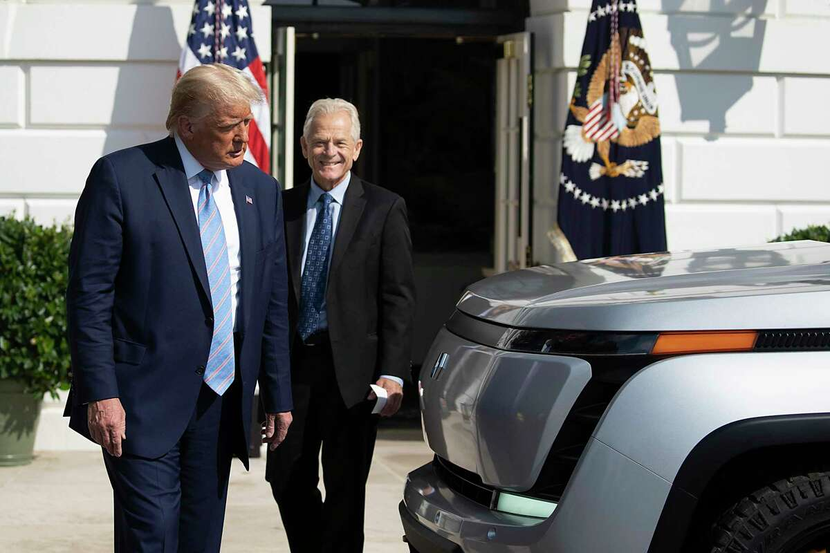 WASHINGTON, DC - SEPTEMBER 28: U.S. President Donald Trump and White House Trade Adviser Peter Navarro check out the new Endurance all-electric pickup truck on the south lawn of the White House on September 28, 2020 in Washington, DC. They bought the old GM Lordstown plant in Ohio to build the Endurance all-electric pickup truck, inside those four wheels are electric motors similar to electric scooters. (Photo by Tasos Katopodis/Getty Images)
