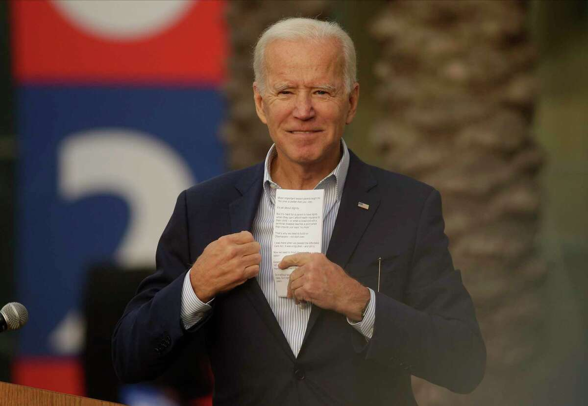 Democratic presidential candidate former Vice President Joe Biden saves his speech notes at the end of a campaign rally at Los Angeles Trade Technical College in Los Angeles Thursday, Nov. 14, 2019. (AP Photo/Damian Dovarganes)