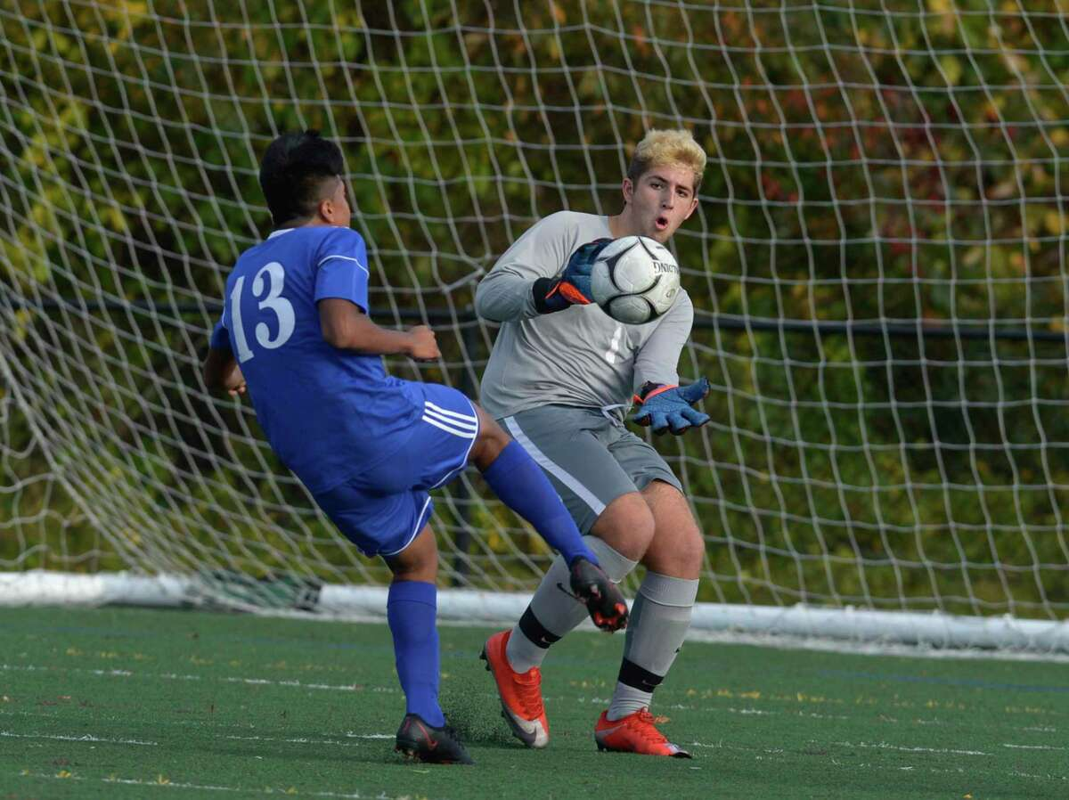 New Milford goalie Daniel Rizvic (1) moves out for a save on a shot by Tech's Brandon Rodriguez (13) in the boys soccer game between New Milford and Abbott Tech high schools, Thursday afternoon at Broadview Middle School, Danbury, Conn.
