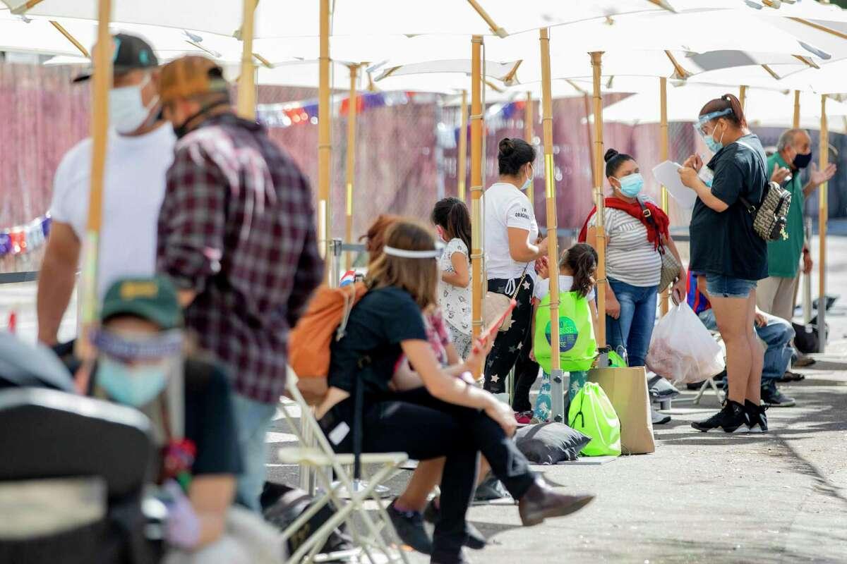 Residents of Oakland's Fruitvale neighborhood line up to for free coronavirus testing last month.