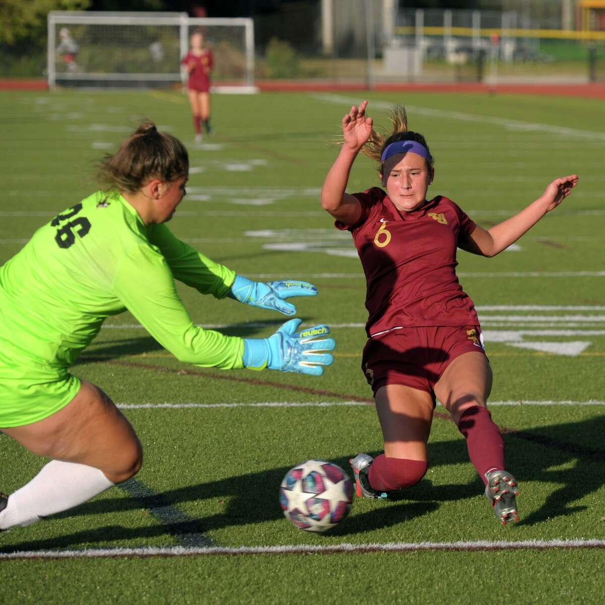 Trumbull goalie Julia Marin runs out to block a kick by St. Joseph's Caroline Sheehan during high school soccer action at St. Joseph High School, in Trumbull, Conn. Oct. 1, 2020.