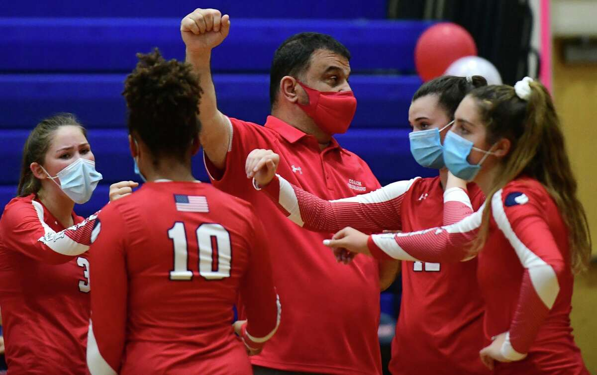 Senator Coach Pete Georgeou talks with his team as The Brien McMahon High School Senators girls volleyball team takes on the Norwalk High School Bears during their intracity game Thursday, October 1, 2020, at Brien McHahon in Norwalk, Conn.