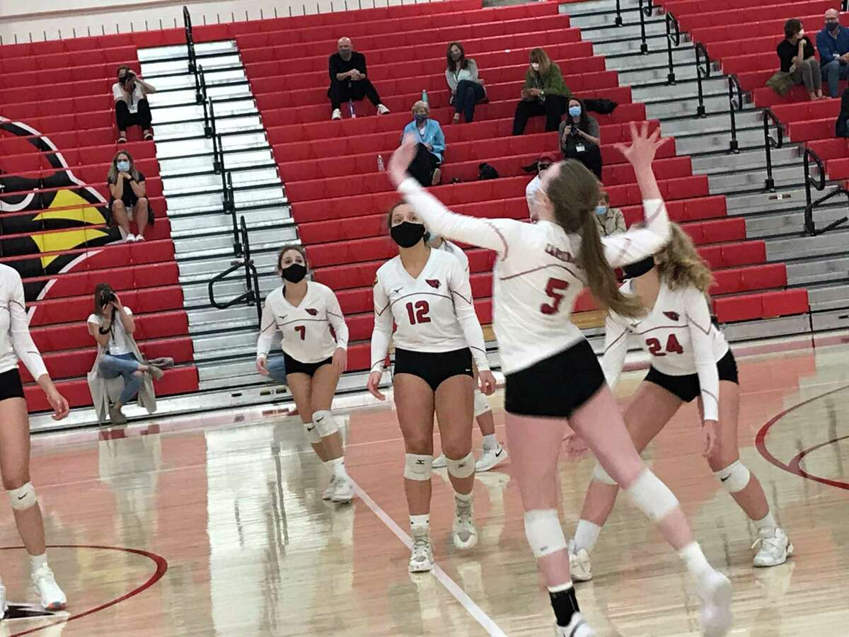 Greenwich High School junior Sophie Jones gets ready to return a serve during the Cardinals' volleyball game against J.M. Wright Technical School on Thursday, October 1, 2020, in Greenwich, Connecticut.