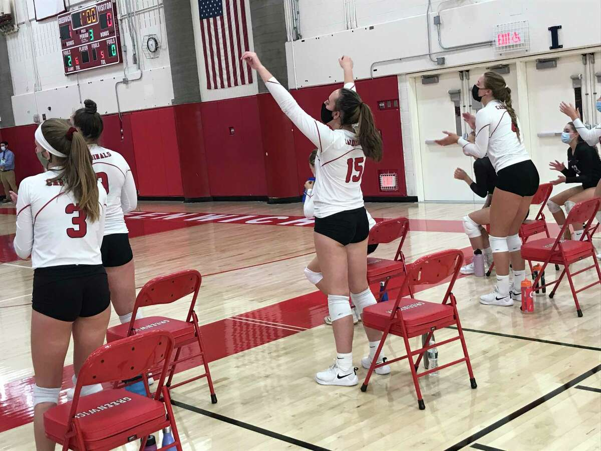 The Greenwich High School girls volleyball team react during their match against J.M. Wright Technical School, while practicing social distancing.