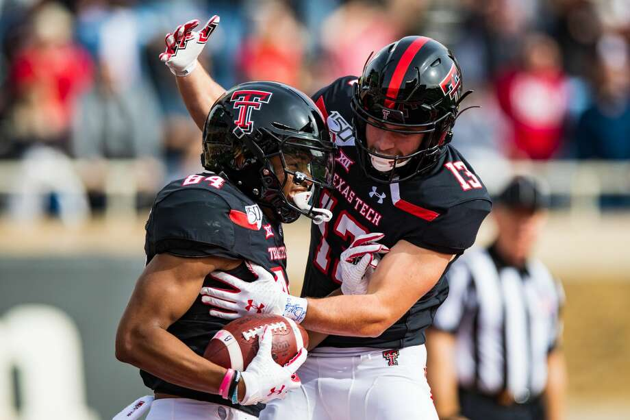 LUBBOCK, TEXAS - NOVEMBER 16: Wide receiver Erik Ezukanma #84 of the Texas Tech Red Raiders is congratulated by receiver McLane Mannix #13 after scoring a touchdown during the second half of the college football game against the TCU Horned Frogs on November 16, 2019 at Jones AT&T Stadium in Lubbock, Texas. (Photo by John E. Moore III/Getty Images) Photo: John E. Moore III/Getty Images / 2019 Getty Images