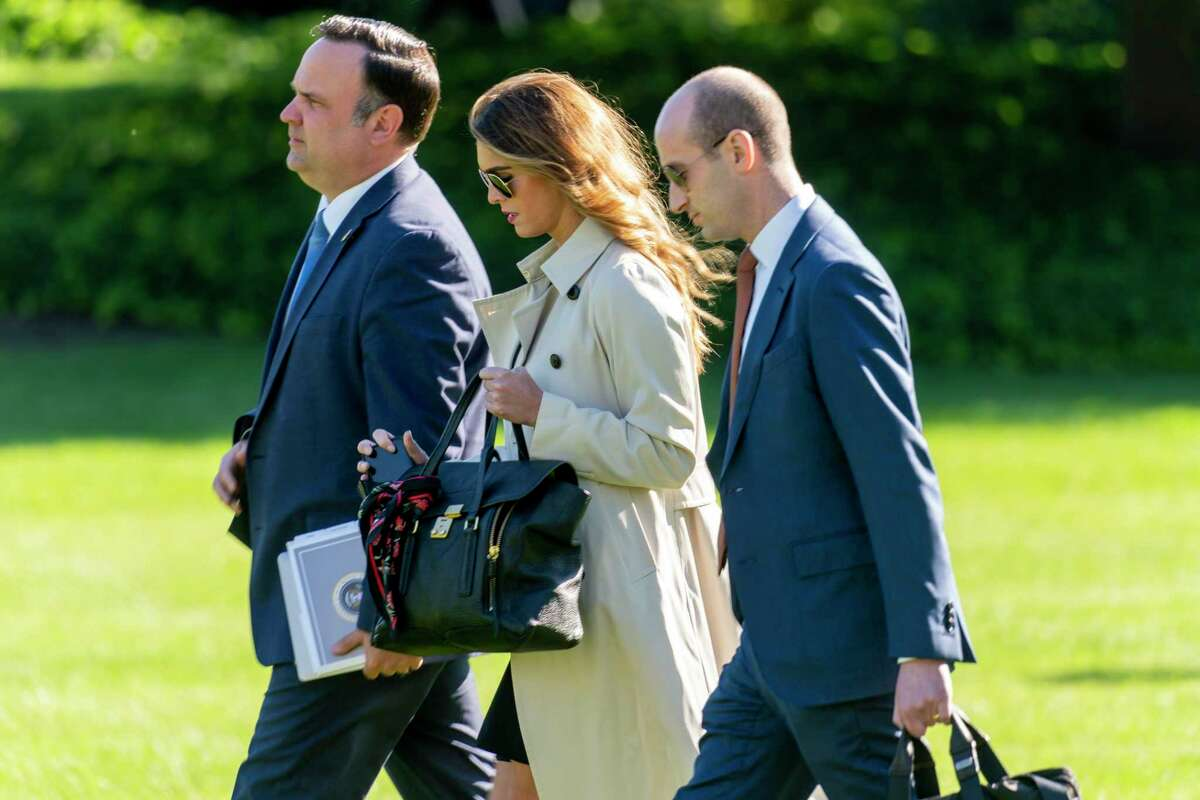 White House Social Media Director Dan Scavino, Counselor to the President Hope Hicks, and President Donald Trump's White House senior adviser Stephen Miller, walk across the South Lawn to board Marine One on the South Lawn of the White House in Washington, Monday, Sept. 21, 2020. Confirmed positive for COVID-19: Tuesday, October 6