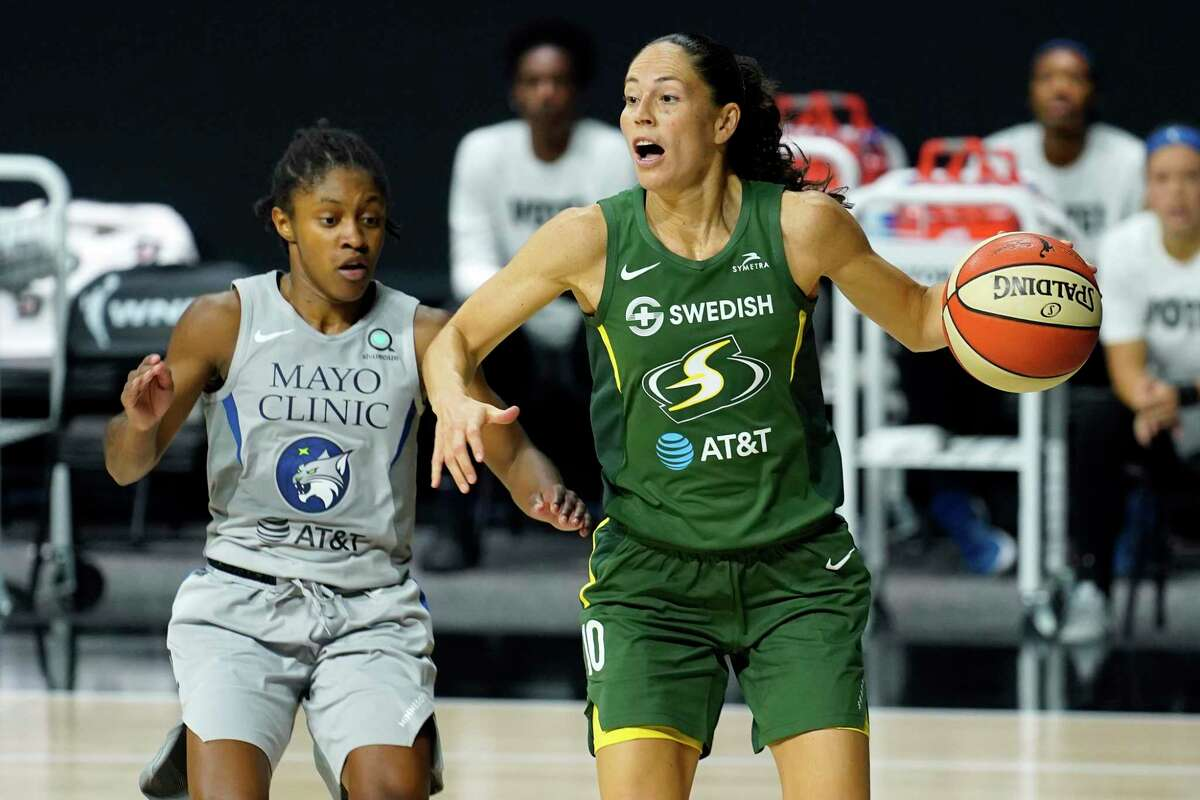 Seattle Storm guard Sue Bird (10) drives around Minnesota Lynx guard Crystal Dangerfield (2) during the second half of Game 2 of a WNBA playoff semifinal last Thursday.