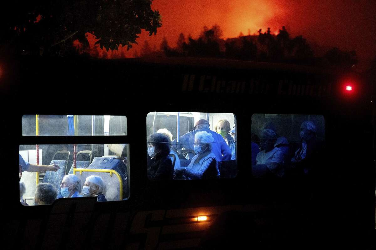 Residents of the Oakmont Gardens senior home in Santa Rosa evacuate on a bus Monday as the Glass Fire nears. Many evacuees had turned in for the night.