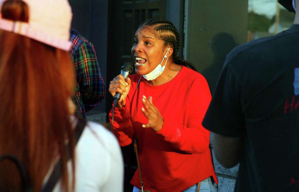 Nicole Tate, mother of Nyair Charles Nixon Jr., speaks during a protest in from of the now shuttered Keystone Mens Club on Barnum Avenue in Bridgeport, Conn., on Thursday Oct. 1, 2020. Some 60 people gathered outside the Keystone to demand the FBI take over the investigation and look into the actions of Bridgeport City Council Member Eneida Martinez, who manages the club were Nixon was shot before stumbling into the street where he was struck by a fleeing car.