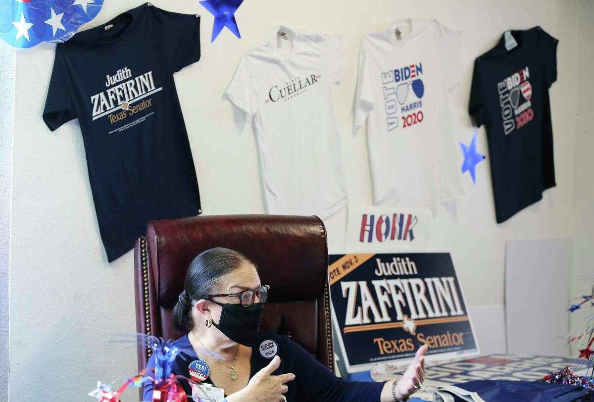 Sylvia Bruni is the Webb County Democratic Chairperson. On the wall are t-shirts for sale of prominent Democrats in the Laredo area including the Biden-Harris campaign shirts.