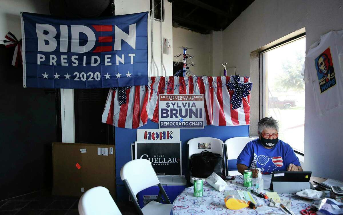 Rosina Vargas sits at a table handwriting notes to prospective voters at the Webb County Democratic Headquarters in Laredo on Wednesday, Sept. 23, 2020.