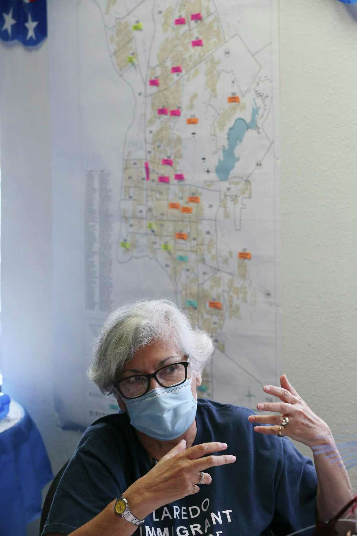 Ana Saenz, Secretary of the Webb County Democratic Party, talks in front of a map of polling precincts in the Laredo area.