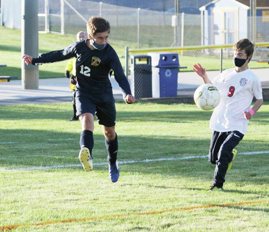 Manistee's Evan Dalhke boots the ball to a teammate during the Chippewas 6-1 win over North Bay on Thursday at Chippewa Field. (Dylan Savela/News Advocate)