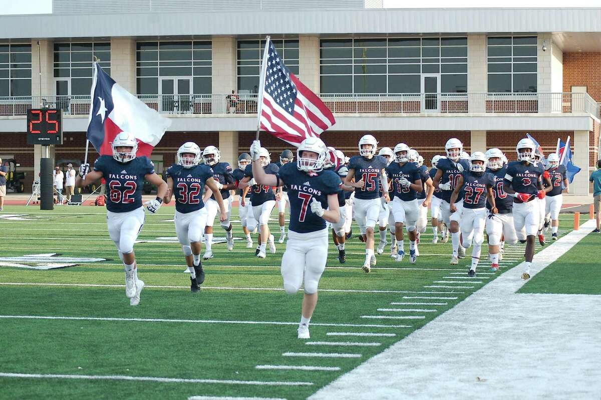 Clear Lake runs onto the field before the game against La Porte Thursday, Oct. 1 at Challenger Columbia Stadium.