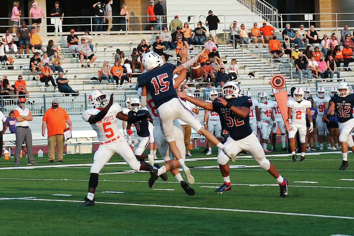 Clear Lake's Carson Sauer (15) breaks up a pass play to La Porte's Champion Traylor (86) Thursday, Oct. 1 at Challenger Columbia Stadium.