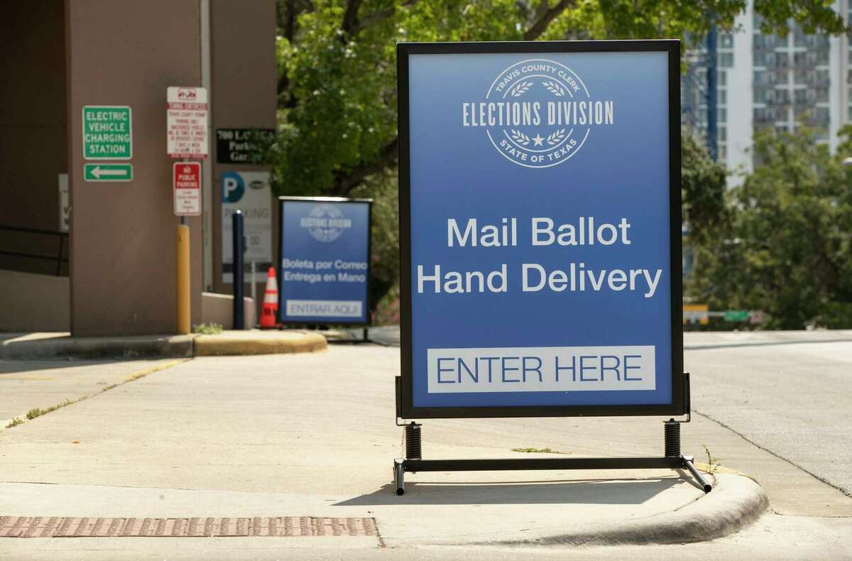 A sign indicates a drive-through ballot drop off location at the 700 Lavaca Parking Garage in Austin, Texas, on Thursday Oct. 1, 2020, shortly after an order was announced by Gov. Greg Abbott restricting such drop off locations. The number of locations where Texas voters can drop off their mail-in ballots has been vastly reduced to ensure poll security, Gov. Greg Abbott said Thursday. (Jay Janner)/Austin American-Statesman via AP)