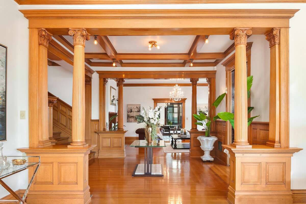 Inside, the home features wood floors, beams, paneling and accents.