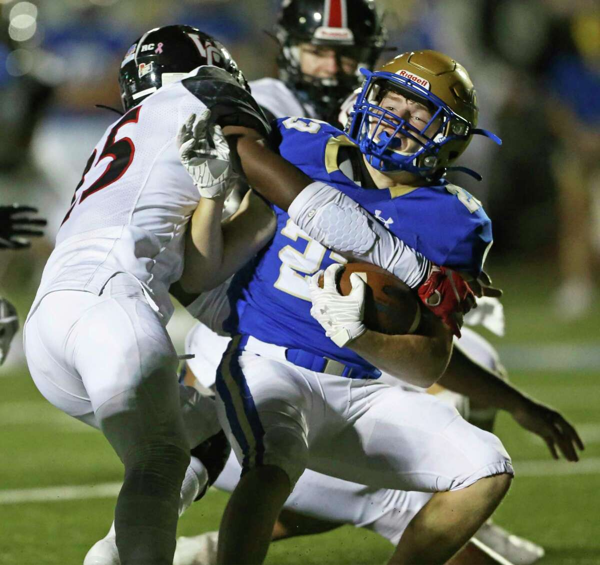 Mule running back George Flesher is brought down hard by Marshall Perez (25) as Alamo Heights hosts Churchill at Commalander Stadium on Oct. 1, 2020.