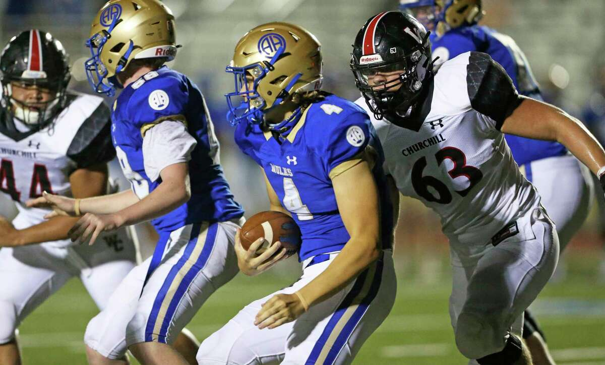 Mule quarterback Chase Christianson is hunted down by Charger defensive lineman Adam MIller as Alamo Heights hosts Churchill at Commalander Stadium on Oct. 1, 2020.
