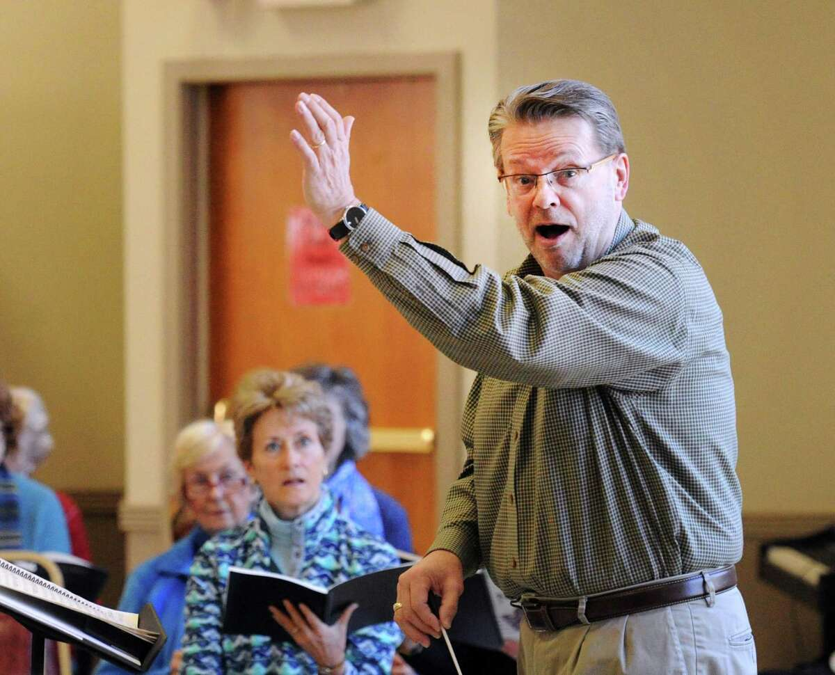 Greenwich Choral Society Music Director Paul Mueller leads the rehearsal at St. Paul's Episcopal Church in the Riverside section of Greenwich, Conn.
